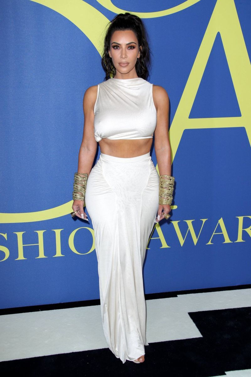 702f0d5c81b The 37-year-old reality TV star showed off her famous curves in a sexy white  ensemble when she hit the red carpet. Kardashian West wore a Rick Owens  crop ...