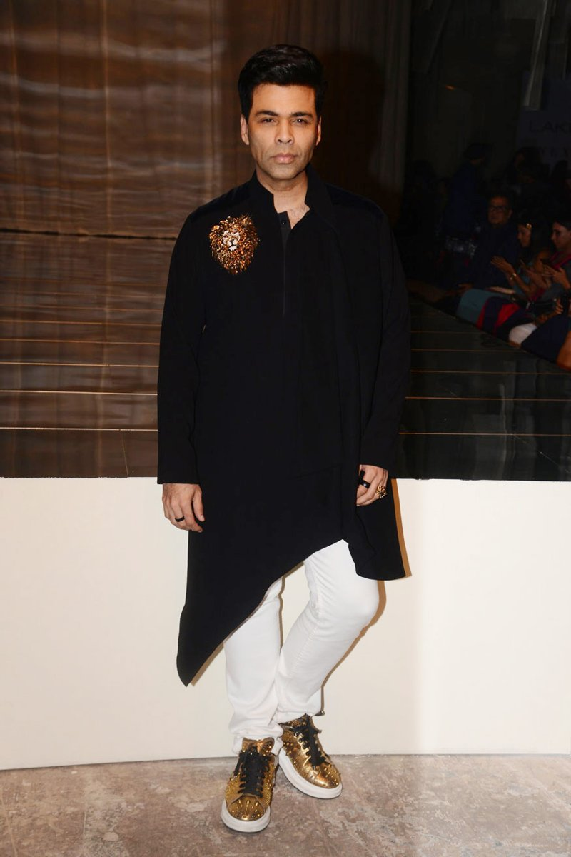 Karan Johar paired his asymmetrical kurta with white and gold shoes.